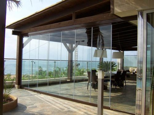 Cierre de terraza dialum cristales especiales para for Cortinas de exterior